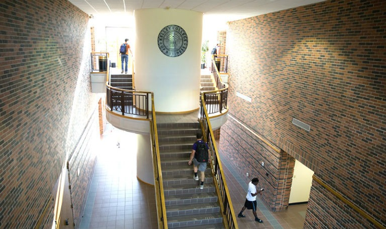 aerial inside view of Kelley College of Business staircase with official Kelley College seal