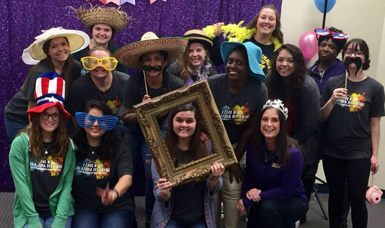 HSU student group photo posed with various costume accessories