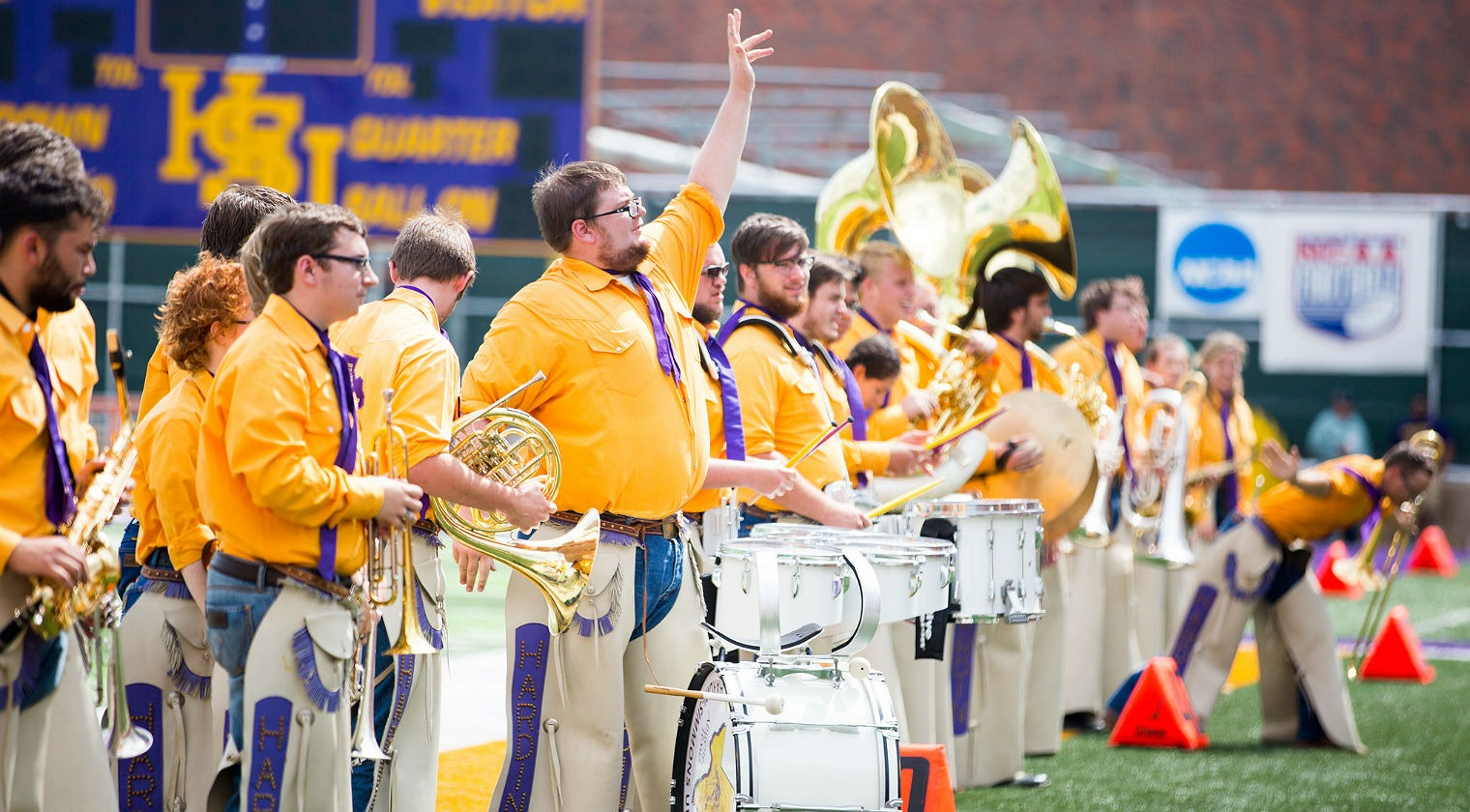 HSU band performing halftime show on football field