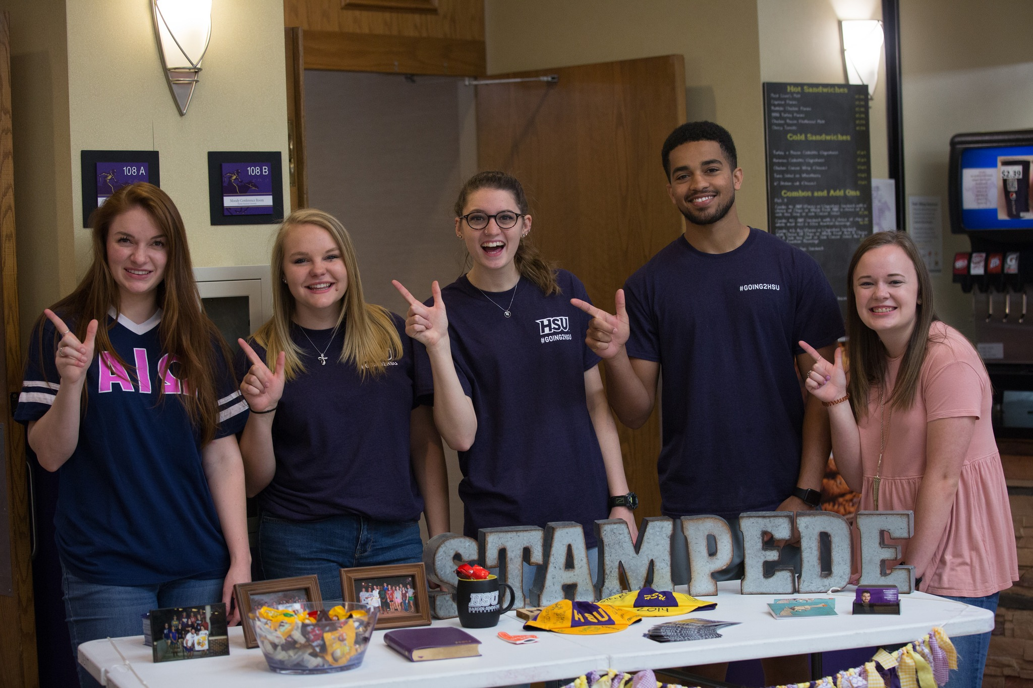 HSU students pose with guns up at STAMPEDE.