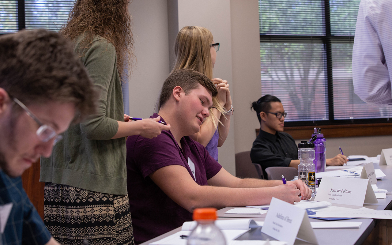 Photo of HSU students participating in Mock United Nations activities.