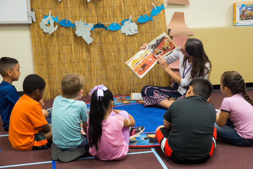 Photo of HSU education student reading to group of young children.