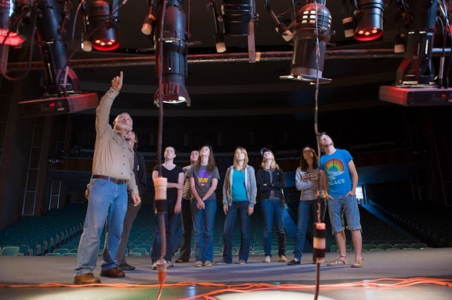 Larry Wheeler speaks to a group of students about the lighting in Van Ellis Theatre.